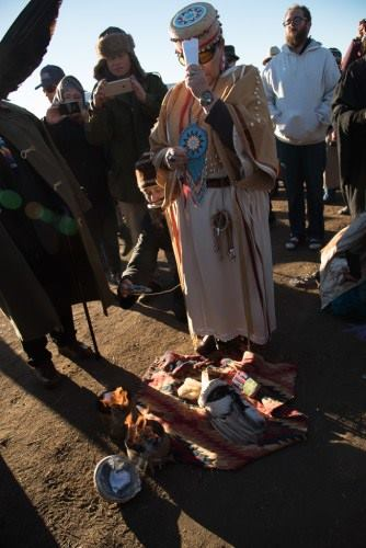At November 2016 clergy gathering at Standing Rock, with more than 530 participants, crowd conducts a ceremony to burn the Doctrine of Discovery. Photo credit: United Church of Christ